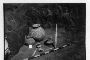 Grave of a cremated deceased with a rather big urn discovered at a depth of 1.09 m. Ceramic amphorae, an iron knife, a bronze vessel – simpulum, a spear and a part of umbo were found around the urn.