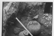 Grave of a cremated deceased discovered at a depth of 0.45 m. Two ceramic vessels, a rather small bronze vessel and amorphous pieces were found around the colored ceramic urn.